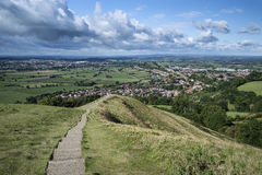 View from top of Glastonbury Tor overlooking Glastonbury town in Royalty Free Stock Photography