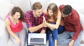 Good friends sitting on the couch and giving each other five. View from the top. good friends sitting on the couch and giving each other five Royalty Free Stock Photography