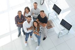 Group of creative professionals standing in office. View the top. a group of creative professionals standing in office and looking up Royalty Free Stock Images