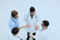 View from the top.a group of doctors discussing ideas royalty free stock photography