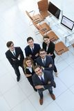 View from the top. a group of friendly colleagues. Looking at the camera Royalty Free Stock Images