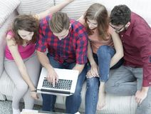 Group of friends with a laptop,discussing the video Stock Photo