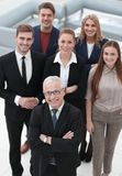 View from the top. group of smiling business people looking at camera. stock photo