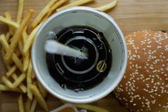 Hamburger french fries and a glass of cola. View from the top on a hamburger french fries and a glass of cola Stock Images