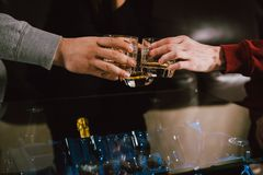 View from the top. Hands of people with glasses of whiskey or wine, celebrating and toasting of the wedding, meeting or other royalty free stock photography