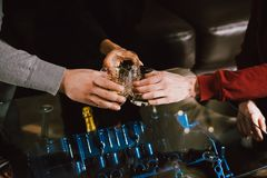 View from the top. Hands of people with glasses of whiskey or wine, celebrating and toasting of the wedding, meeting or other stock photo