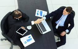View from the top.handshake of business partners above the Desk Stock Images