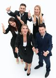 View from the top.happy business team holding up a thumbs up. On a white background Stock Photos