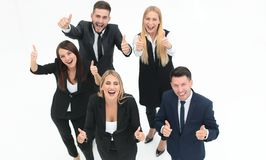 View from the top.happy business team holding up a thumbs up. On a white background Stock Images