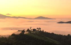 View on top of the hill during the misty sunrise at yun lai viewpoint, pai, thailand. View of a beautiful misty morning on the top of the hill during the misty Stock Photo