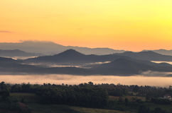 View on top of the hill during the misty sunrise at yun lai viewpoint, pai, thailand. Stock Image