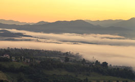 View on top of the hill during the misty sunrise at yun lai viewpoint, pai, thailand. Royalty Free Stock Image