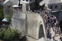 View from the top of the historic Mostar bridge crowded with people. MOSTAR, BOSNIA AND HERZEGOVINA - AUGUST17 2017: View from the top of the historic Mostar Stock Images