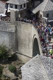 View from the top of the historic Mostar bridge crowded with people. MOSTAR, BOSNIA AND HERZEGOVINA - AUGUST17 2017: View from the top of the historic Mostar Stock Photos