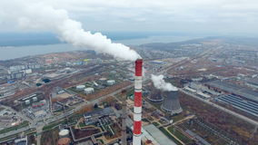 The view from the top - industrial plant pipe smoking in a industrial area. Thermal power plant. stock video
