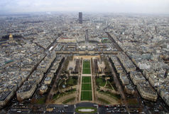 View from the top level of the Eiffel Tower, down the Champ de Mars, with the Tour Montparnasse in rainy day, Paris, Fra Stock Photo