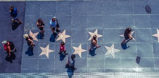 Hollywood/Los Angeles/California/USA - 07.19.2013: View from the top at lots of people walking on the sidewalk Walk Of Fame stock photography