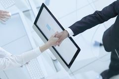 View from the top. Manager shaking hands with the employee. Over a work Desk Royalty Free Stock Photo