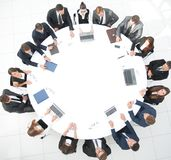 View from the top.meeting of shareholders of the company at the round - table. Meeting of shareholders of the company at the round - table.the concept of royalty free stock photos