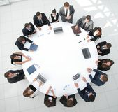 View from the top.meeting of shareholders of the company at the round - table. Stock Photo