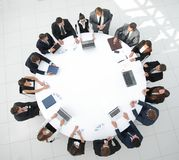 View from the top.meeting of shareholders of the company at the round - table. Meeting of shareholders of the company at the round - table.the concept of Stock Images