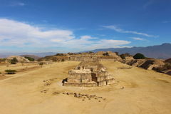 View from the top of Monte Alban. A view of dramatic contrast between the washed stone of the Zapotec ruins outside Oaxaca, Mexico and the Azure sky Stock Image