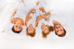 View from top of mother, father, two kids on bed Stock Image