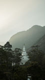 The view on top of the mountain Adam`s Peak on sunset buddha temple. Sri Lanka stock images