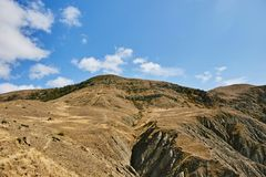 View of the top of the mountain from its foot stock photography