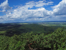 View from top of the mountain in Jeseniky- hills, trees, village royalty free stock photography