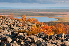 View from the top of a mountain over a lake in Lapland Stock Photography