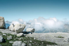 View from the top of the mountain. Skyline view from the top of the mountain with clouds in background Stock Photo