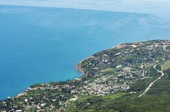 View from the top of the mountain to the seaside town stock photos