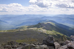 View from the top of Mt. Washington with the Appalachian trail leading up. Weather is constantly changing at Mt. Washington but this was just a beautiful day Royalty Free Stock Photos