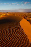 View from top of Namibian dune across foggy desert to dunes ridge Stock Photography