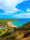 View from the top of The Nut in Stanley Tasmania blue ocean and clouds Stock Photo