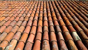 The view from the top of the old red-orange-brown tiles. The roof of the old house.  Royalty Free Stock Photography