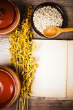 View from the top of open book of recipes and cooking utensil Stock Image