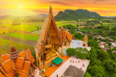 A view from the top of the pagoda, golden buddha statue with rice fields and mountain, Tiger Cave Temple (Wat Tham Seua) Thai and. A view from the top of the stock images