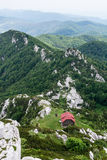 View from the top of peak to a mountain shelter Royalty Free Stock Photo