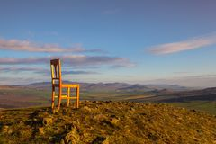 View from the top of Rana hill and wooden chair at sunrise. Royalty Free Stock Images