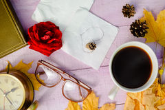 View from top on red rose, glasses, alarm clock Royalty Free Stock Photography
