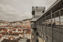 A view of the top of The Santa Justa lift, Lisbon, Portugal. A view the city center of Lisbon on a cloudy winter day. The image shows red-tiled roofs of the Royalty Free Stock Photography