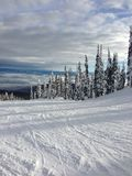 View from top of ski hill on sunny day in winter Stock Images