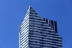 View of the top of skyscraper against the sky. Example of modern architecture. View of the top of skyscraper against the sky Stock Photography