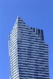 View of the top of skyscraper against the sky. Example of modern architecture. View of the top of skyscraper against the sky Stock Photo