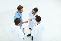 Smiling group of doctors discussing. View from the top.smiling group of doctors discussing .photo with copy space Stock Images