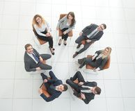 Successful business team sitting in a circle. View from the top.successful business team sitting in a circle and looking at the camera Stock Photos
