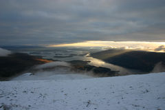 View from the top. The sun sets on Loch Lomond, Scotland.  Taken from the top of Ben Lomond Stock Image