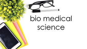 VIEW FROM THE TOP, TABLE WORKING WITH TEXT `BIO MEDICAL SCIENCE` Stock Image